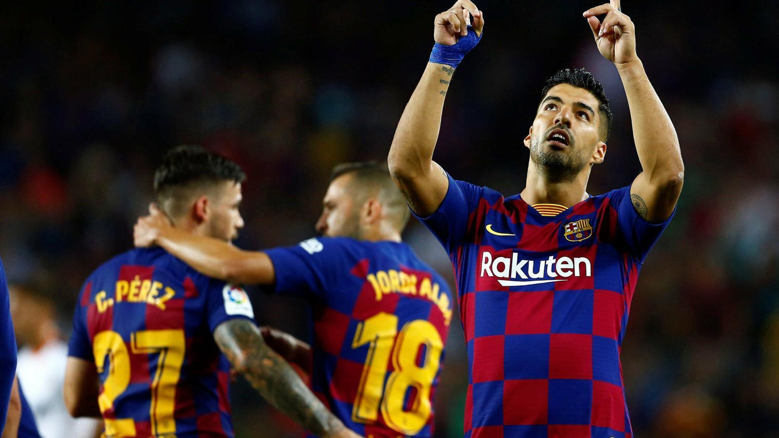 Luis Suárez, davanter uruguaià del Barça, celebrant un gol contra el València al Camp Nou.