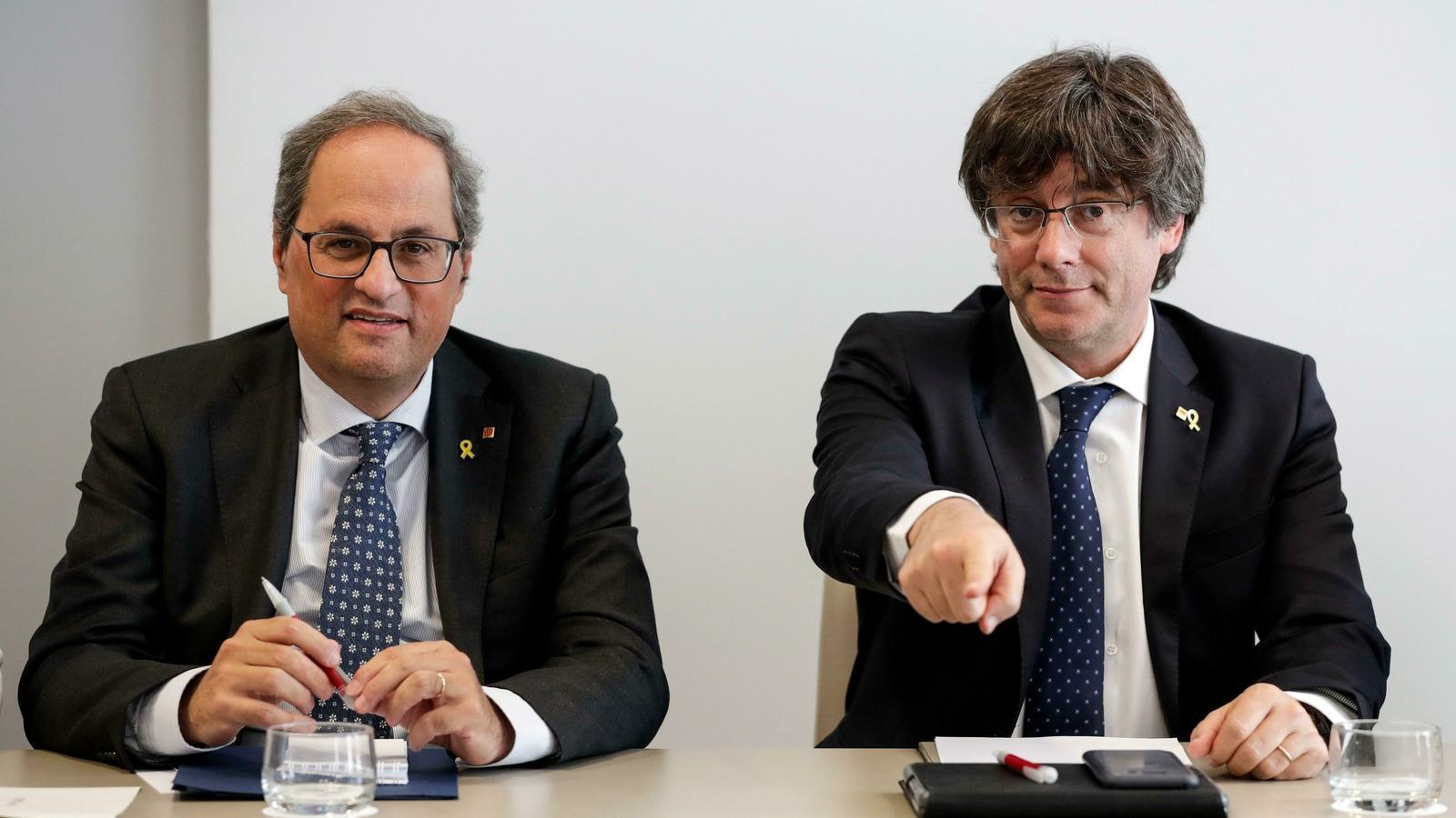 L'expresident Carles Puigdemont i el president Quim Torra, en una imatge d'arxiu.