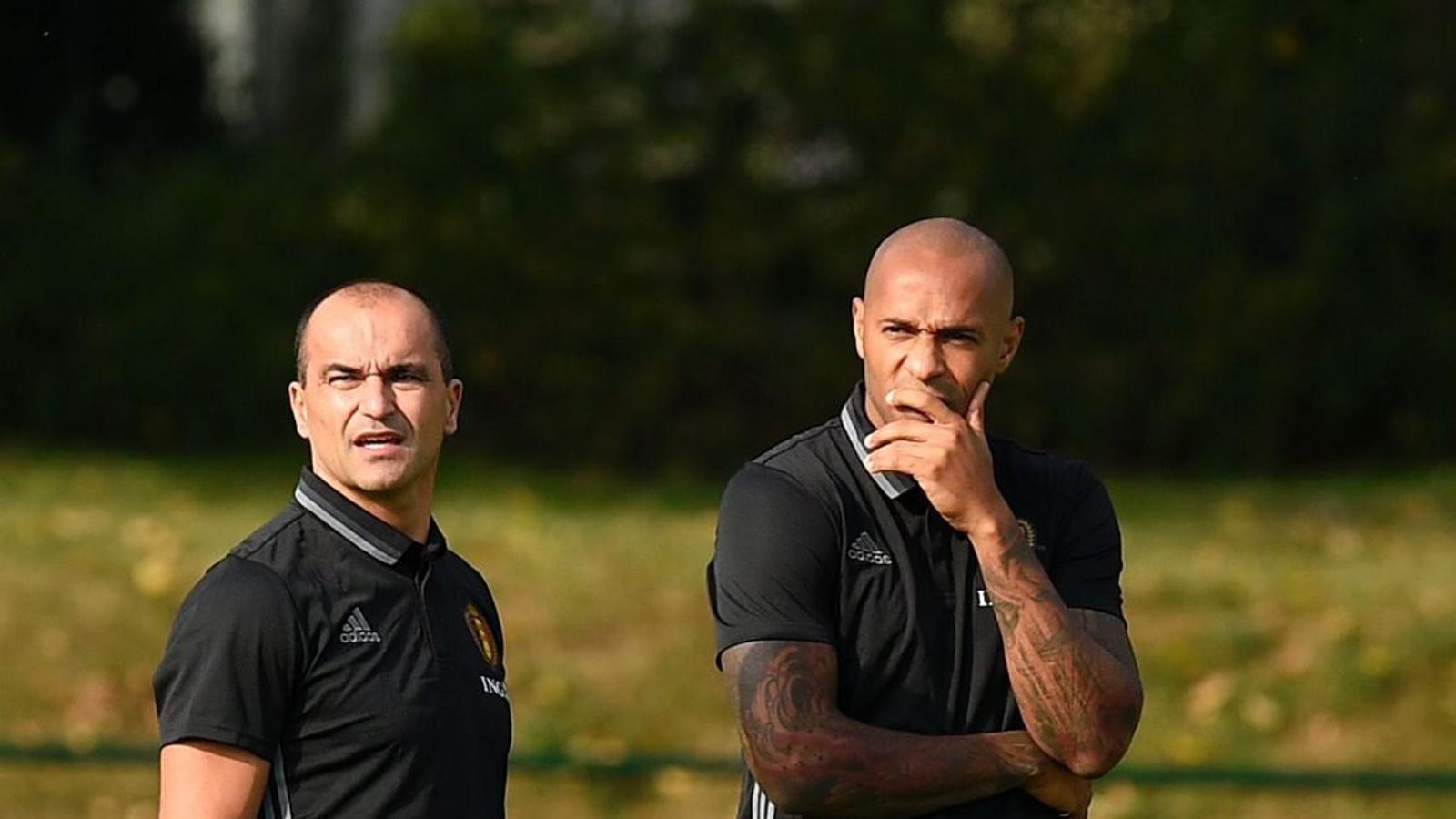 El català Robert Martínez i el francès Thierry Henry durant l'entrenament de la selecció belga.