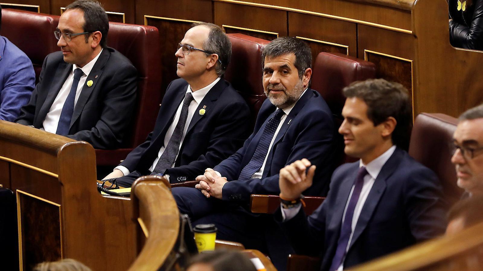 Jordi Sànchez, Jordi Turull i Josep Rull asseguts al Congrés durant la sessió de constitució de la cambra baixa el passat mes de maig.