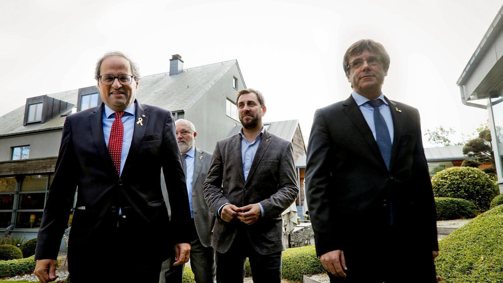 L'expresident Carles Puigdemont amb el president, Quim Torra, i els exconsellers Lluís Puig i Toni Comín.