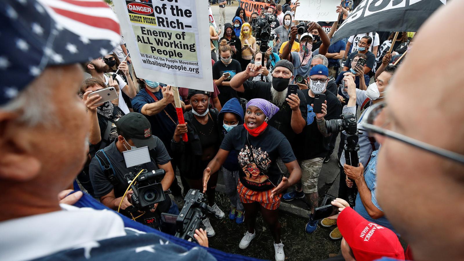 Crits contra la visita de Donald Trump a Kenosha, escenari de protestes contra la discriminació racial.