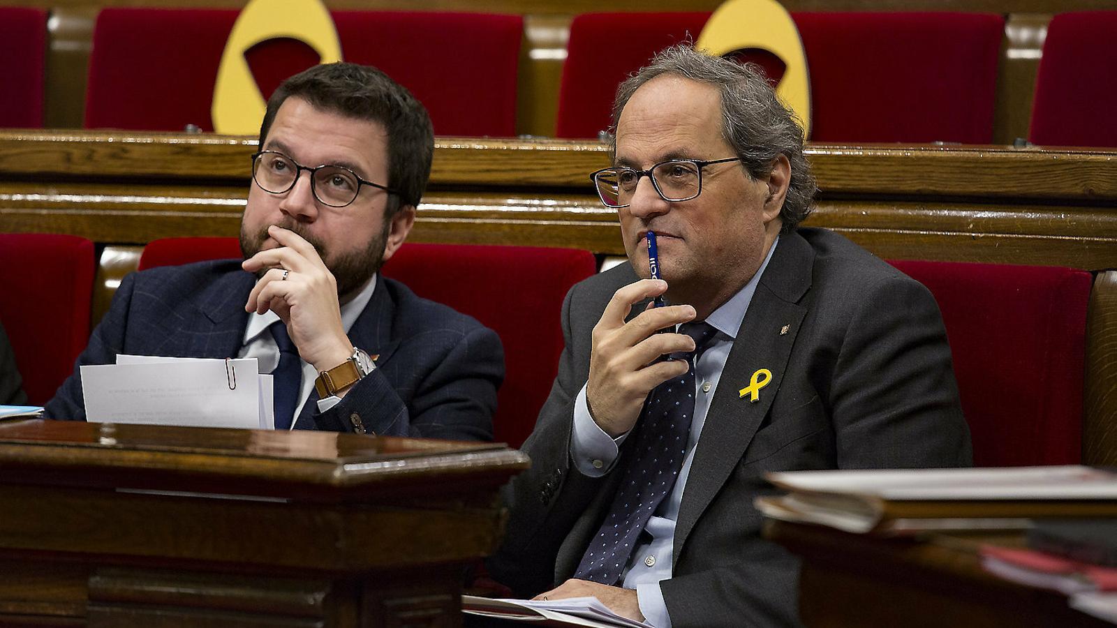 Pere Aragonès i Quim Torra en una imatge d'arxiu al Parlament / FRANCESC MELCION