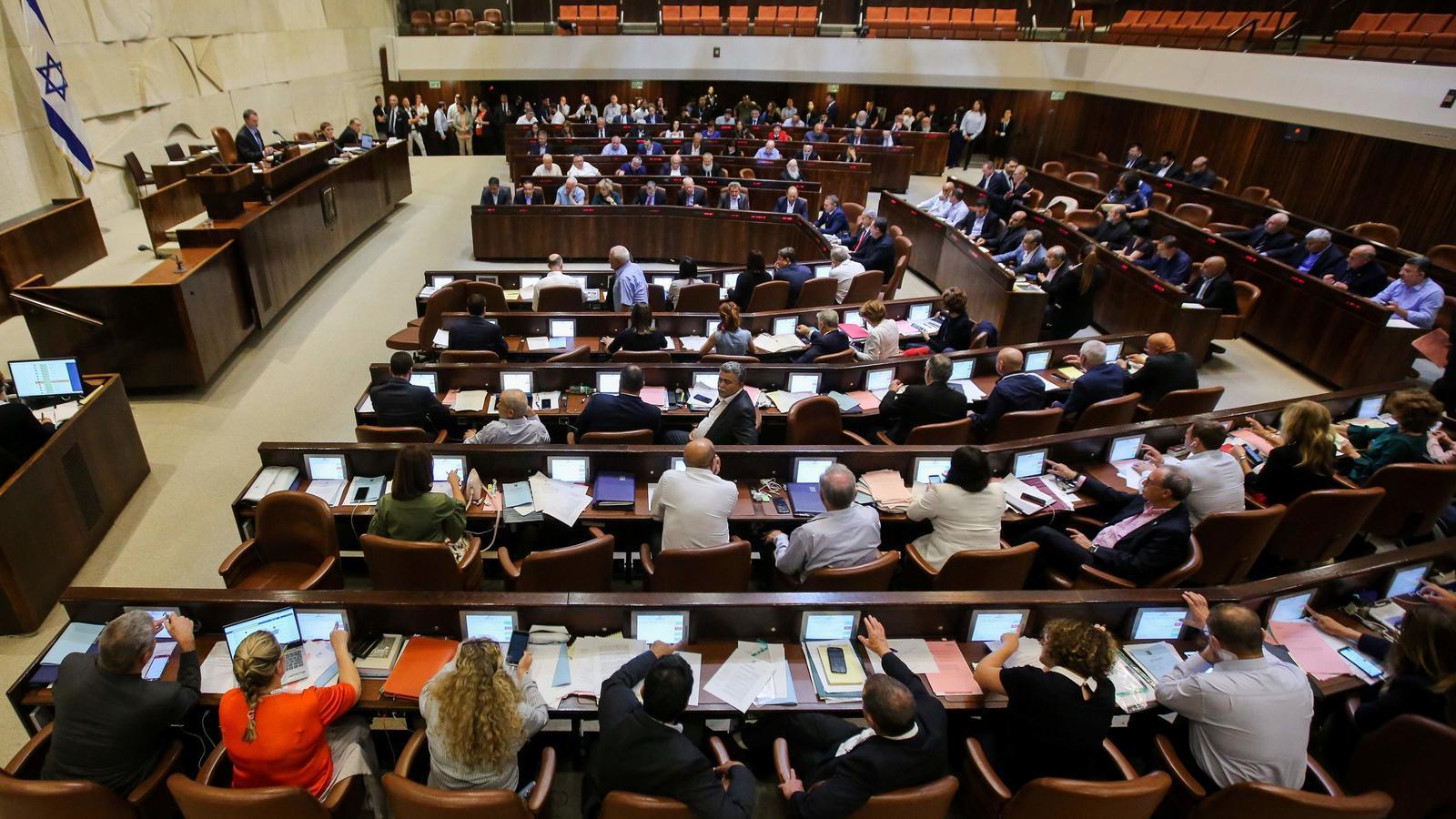 Els membres del Parlament israelià durant la sessió que ha aprovat la nova llei