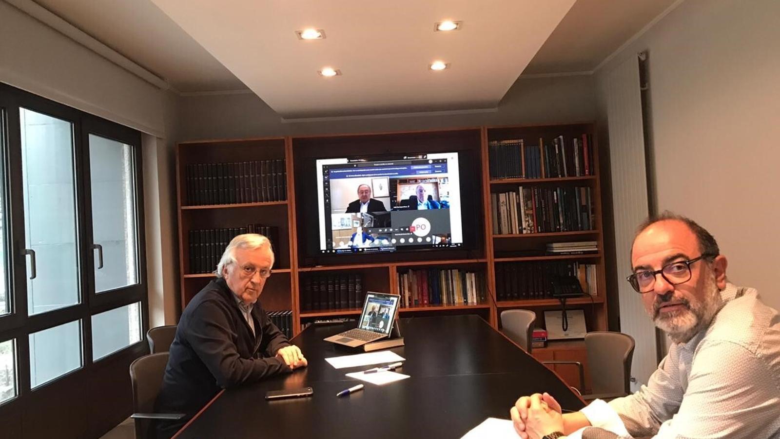 Miquel Armengol, president de la Cambra de Comerç, Indústria i Serveis d'Andorra i Jordi Daban, vicepresident de Turisme de la Cambra de Comerç, Indústria i Serveis d'Andorra, durant la trobada virtual.  / CAMBRA DE COMERÇ