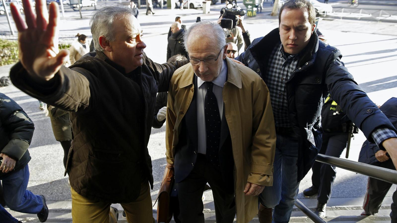Escridassen Rodrigo Rato quan entrava a declarar als jutjats de Madrid