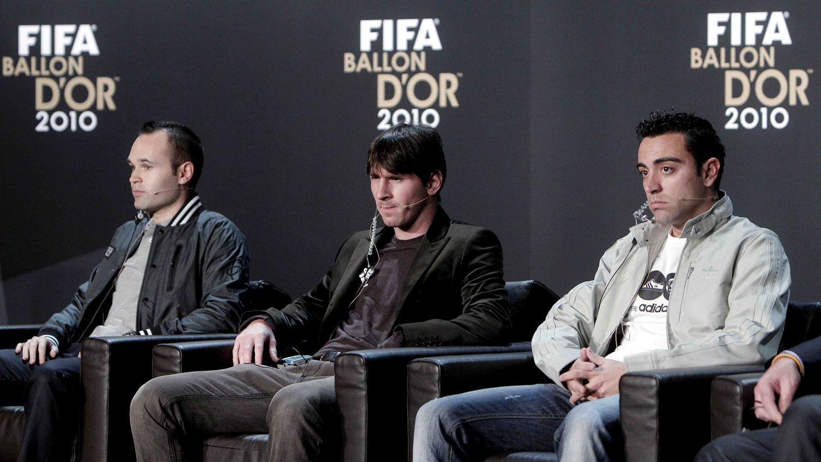 Iniesta, Messi i Xavi, durant la roda de premsa.