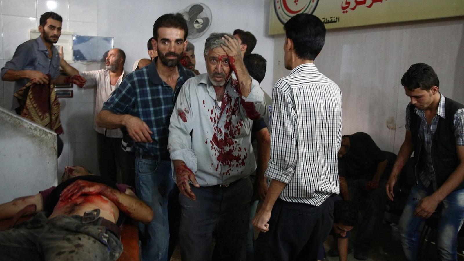 Ferits en el bombardeig d'un mercat a Duma (Síria), atacat pel règim / AFP