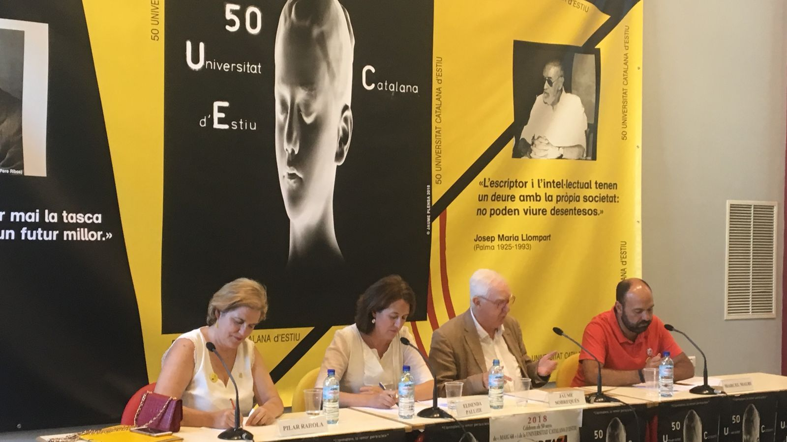 La presidenta de l'ANC, Elisenda Paluzie, i el portaveu d'Òmnium, Marcel Mauri, en l'acte de la Universitat Catalana d'Estiu
