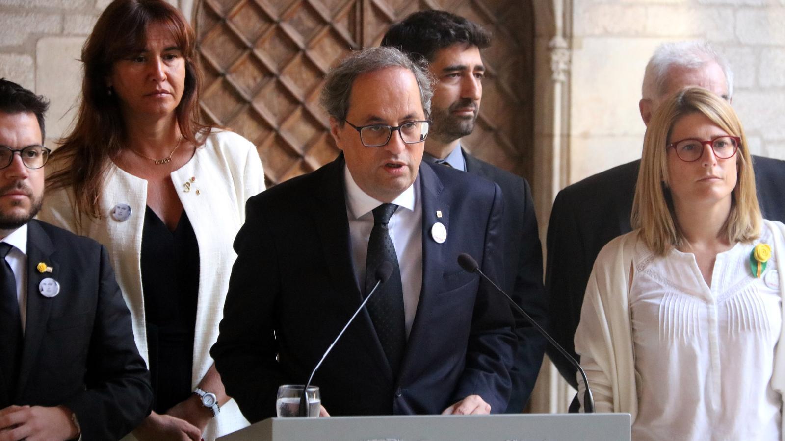 El president de la Generalitat, Quim Torra, ha llegit aquest divendres la declaració institucional amb motiu del 17-A flanquejat pels membres del seu Govern