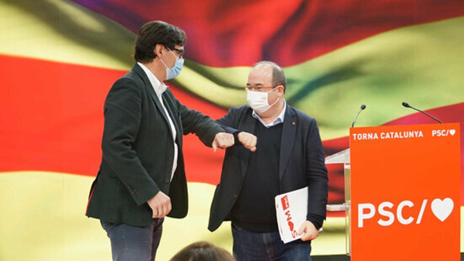 El candidat del PSC el 14-F, Salvador Illa, i el primer secretari del partit, Miquel Iceta, en un acte de precampanya