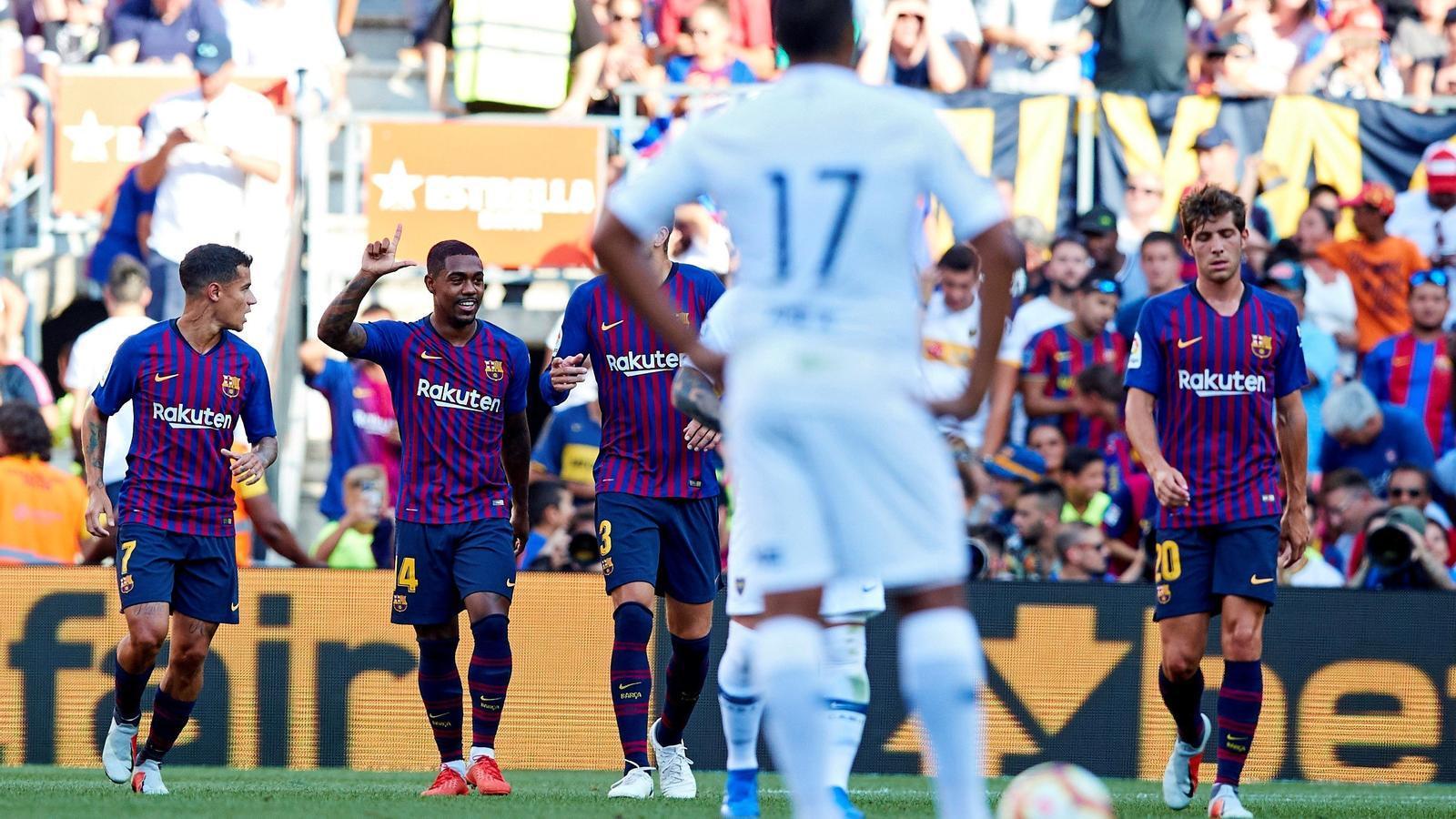 El Barça celebra el gol de Malcom al Gamper