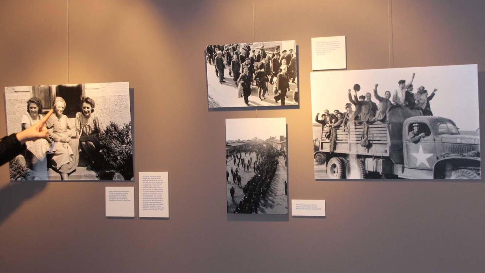 Diverses fotografies de Francesc Boix. La responsable del CAEE, Ruth Casabella, assenyala Anna Pointner (al mig), amb les seves filles, Christine i Leopoldine, veïnes de la localitat de Mauthausen, que van guardar els negatius de Boix per conservar el testimoni de l'horror. / E.  J. M. (ANA)