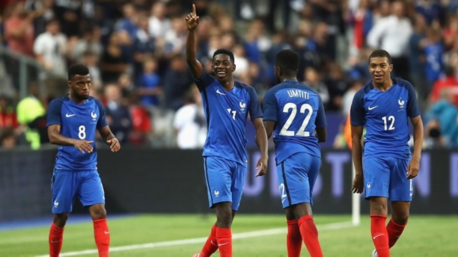 Demblélé, durant un partit amb França
