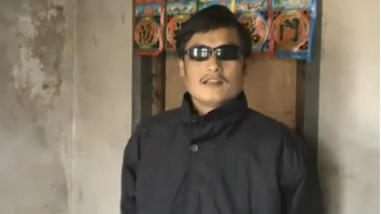 Un activista xinès denuncia que es troba en arrest domiciliari