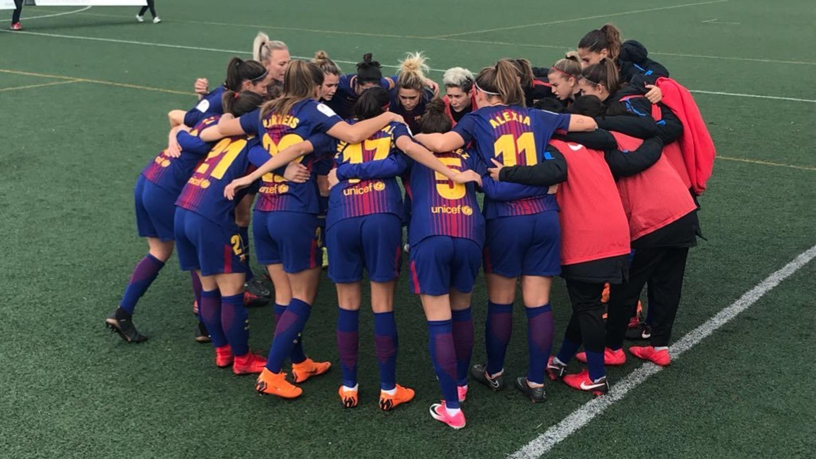 Les jugadores del Barça, abans del partit contra l'Sporting de Huelva