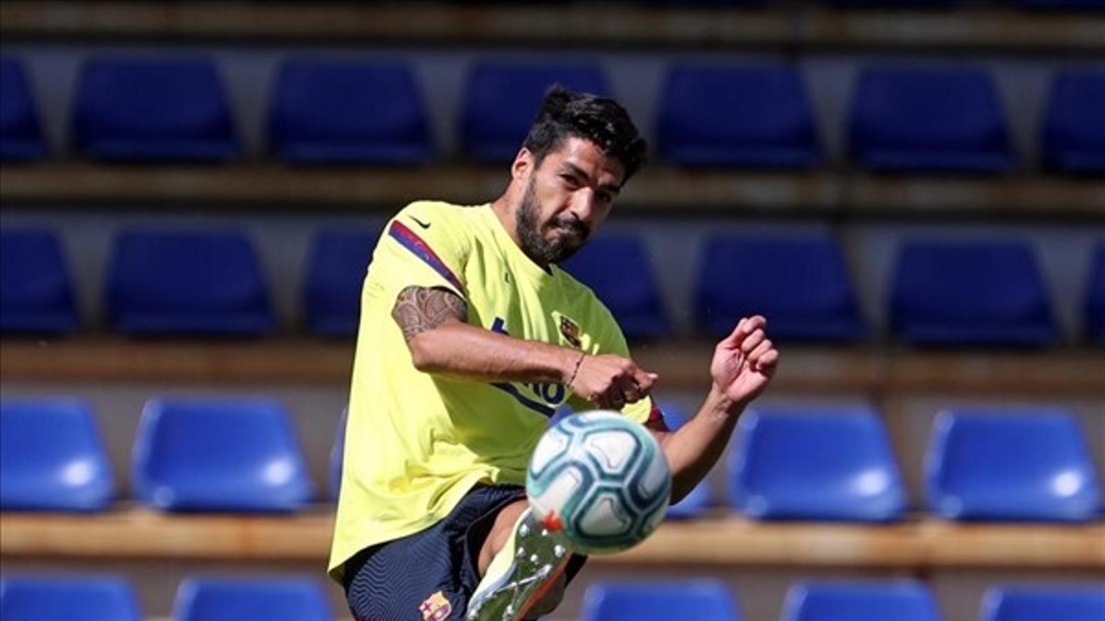 Suárez rep l'alta mèdica i Messi es torna a exercitar