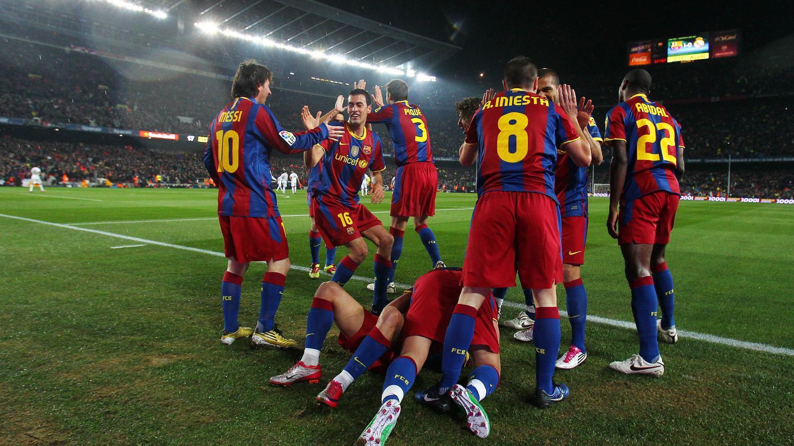 Els jugadors del Barça celebren la victòria