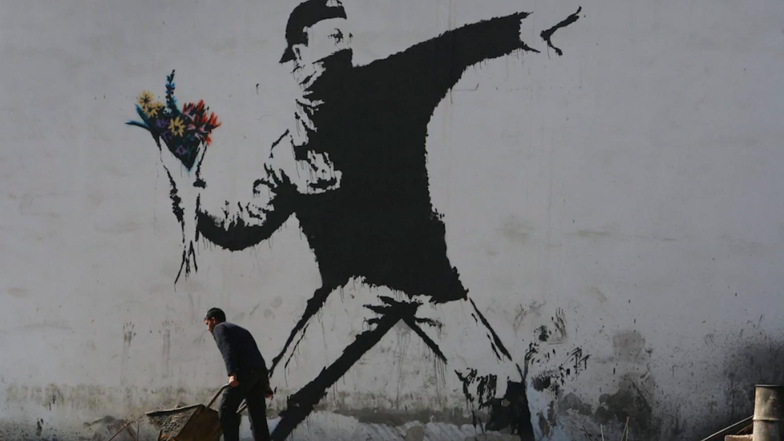 El Llançador de Flors, una de les obres més conegudes de Banksy, apareguda a Jerusalem el 2003