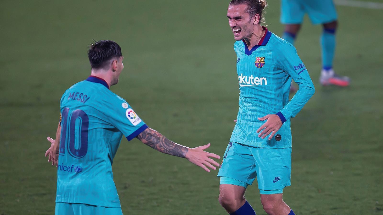 Messi i Griezmann a la celebració del gol contra l'Espanyol